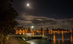 muzzpix-nz posted a photo:	Facebook    | 500px  | WebsiteThe full moon rising over the jetty at Pilot Bay , Mount Maunganui . In fact this was the eclipse moon which turned red that nite but the cloud cover spoiled the show for my vantage point … bummer .