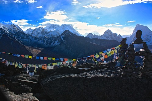 prayer flags glow in the sunrise on Gokyo Ri