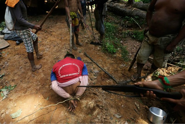 1_amazon-indians-strip-tie-beat-illegal-loggers (6).jpg