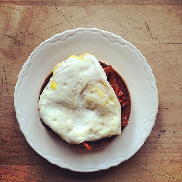 Half a bagel, fried egg, kimchi.