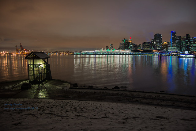 Nine O'Clock Gun with a light snowfall- Vancouver Skyline.