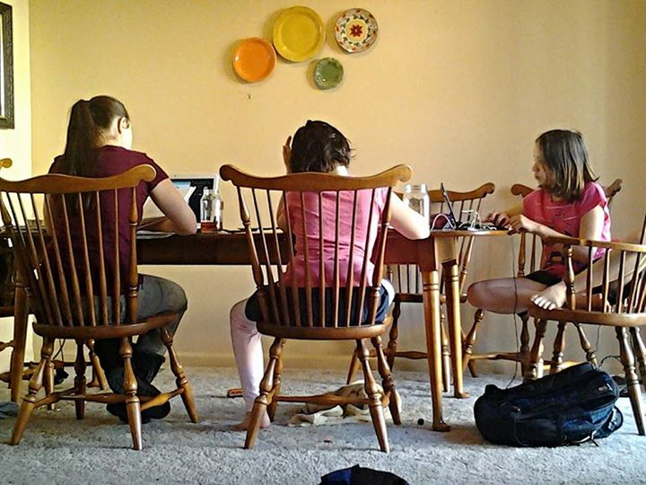 Homeschool Kids Working at Dining Room Table