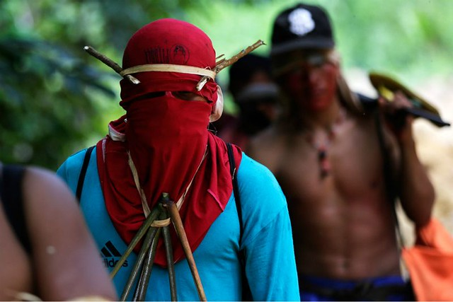 1_amazon-indians-strip-tie-beat-illegal-loggers (5).jpg