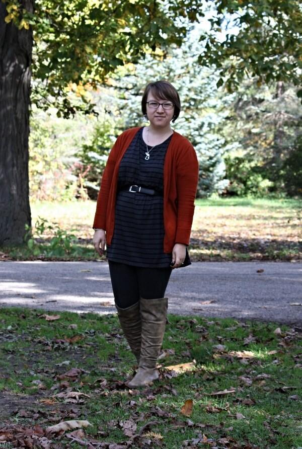 orange cardi, striped tunic, leggings, over the knee boots