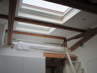 a room with skylights and a loft we did not use