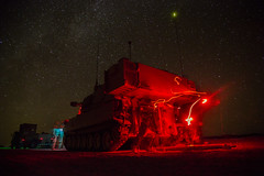 FORT IRWIN, Calif. - U.S. Army Soldiers, assigned to Bravo Company, 1st Battalion, 77th Armor Regiment, 4th Armored Brigade Combat Team, 1st Armored Division, provide security with a M109A6 Paladin prior to a reconnaissance patrol during Decisive Action R