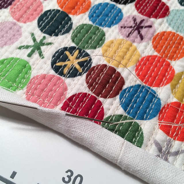 Stitching a single fold binding on my mini quilt. #scraptastictuesday #itstimeforcolour