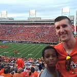 OSU Department of Wellness employee Scott Linderer attends the OSU football game with Daveyon, his little from Big Brothers Big Sisters. Stanley donated the tickets the pair used.