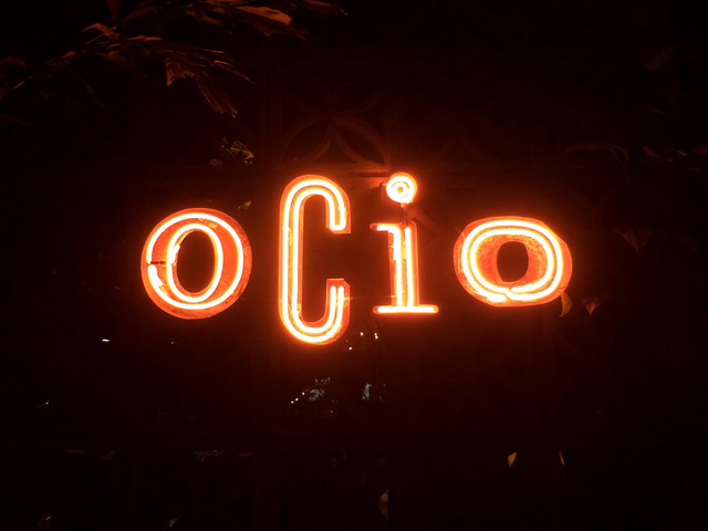 The red neon sign outside Ocio