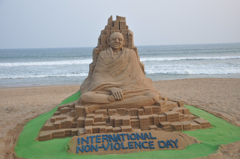 Sand sculpture to celebrate Non violence Day on the golden sea beach Puri