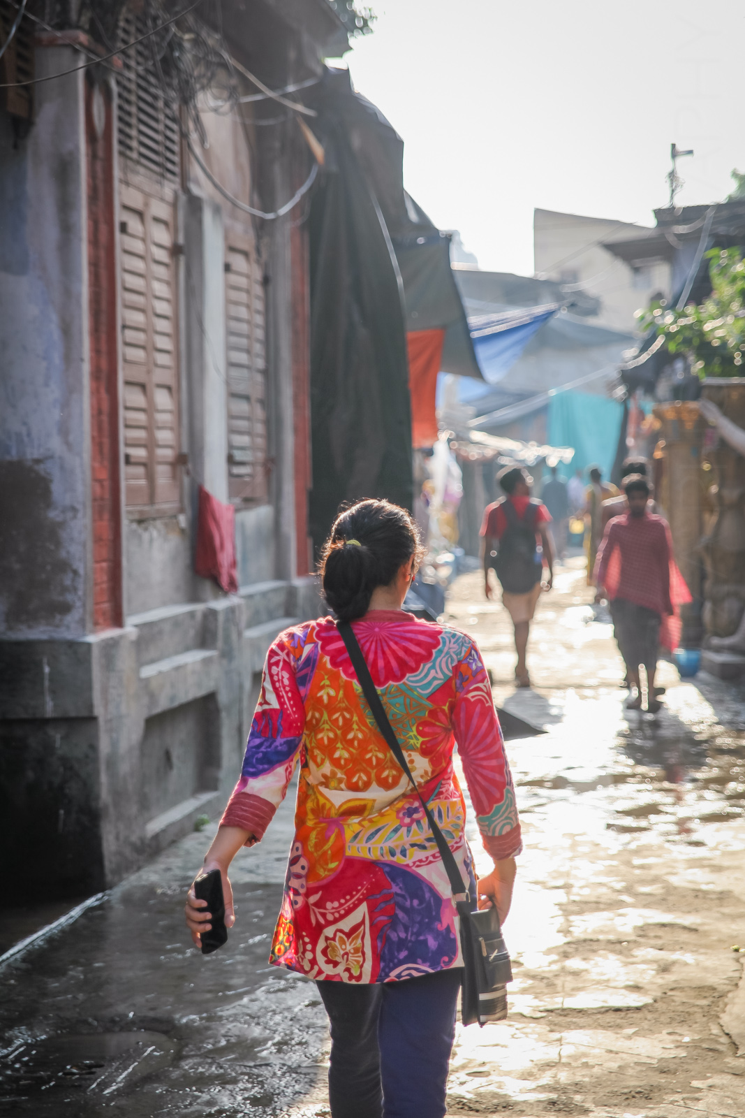 Priya walks through the alleys of Kumortuli