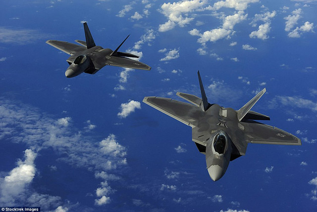 The $139million F-22 stealth fighter jet saw combat for the first time ever during the strikes over Raqqa. Two of the jets are pictured here, over Guam.