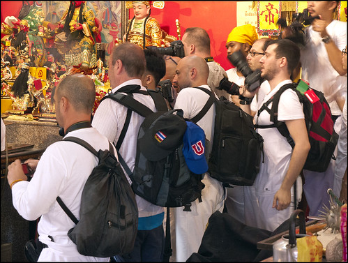 Want to get a good photo? Good luck getting in front of the pros with their big backpacks.