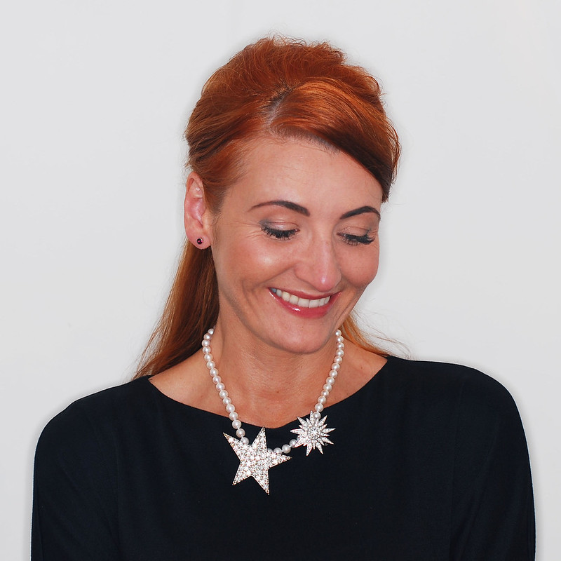 4 Modern Ways to Style a Classic Pearl Necklace | 1. With diamanté brooches
