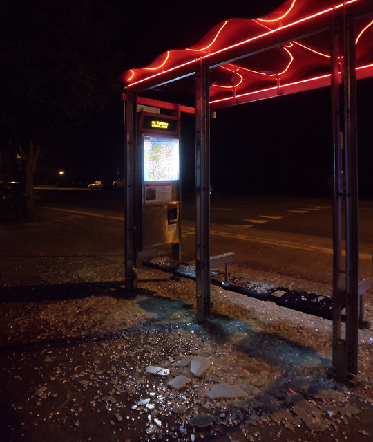 MUNI bus stop, shattered glass; Lincoln Way, The Sunset, San Francisco (2014)
