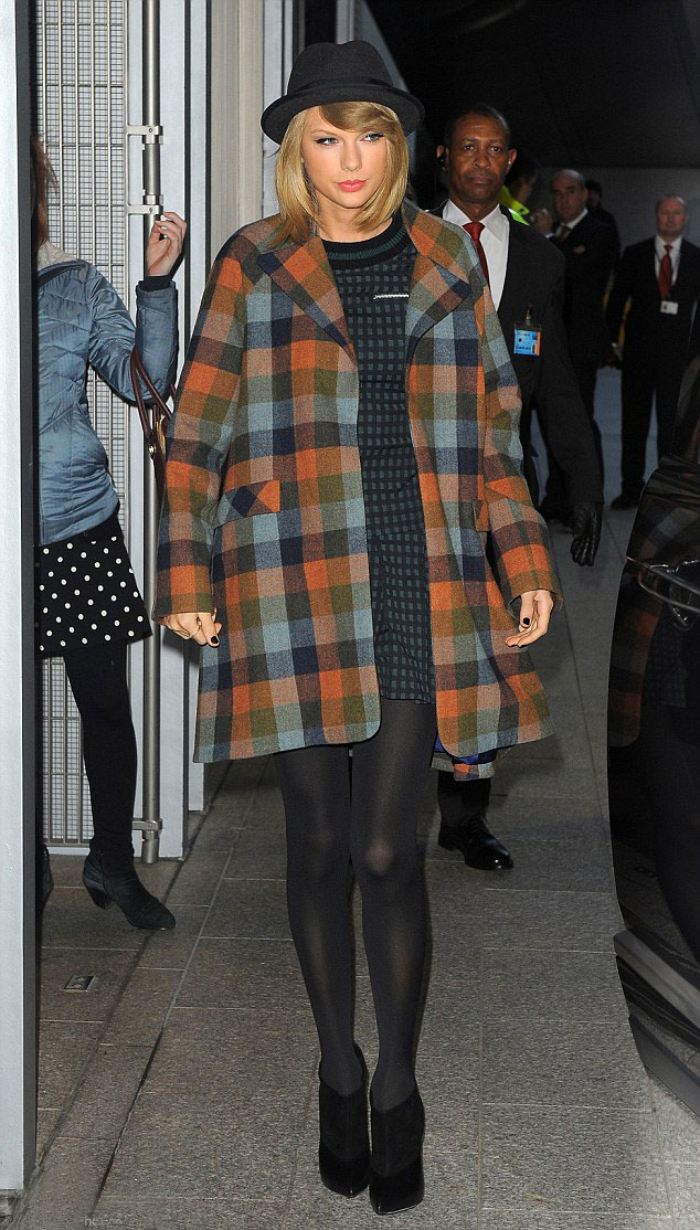 Brown-checked-overcoat-with-a-top-&-a-matching-skirt