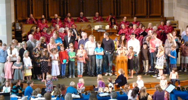The 3rd graders and their families receive a new Bible during worship