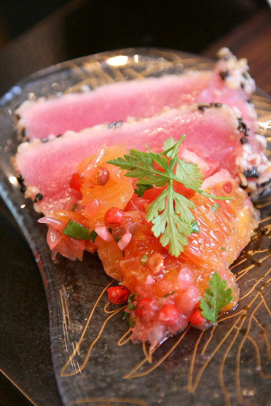 Yellow Fin Tuna Tataki coated with sesame seeds, citrus salsa
