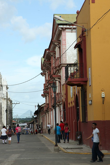 A typical street in León with a volcano for a backdrop