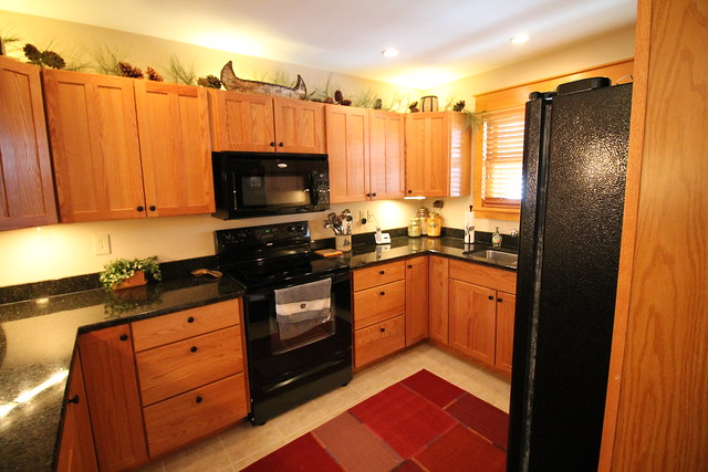 well equipped kitchen with granite counter tops and high end appliances;