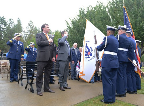 Rear Adm. Richard T. Gromlich, commander of the Coast Guard 13th District, salutes as a color guard comprised of Seattle-area Coast Guardsmen presents the colors during a memorial ceremony for Signalman 1st Class Douglas Munro at his gravesite in Cle Elum, Wash., Sept. 26, 2014. Munro was killed by enemy fire while evacuating a group of Marines from the beaches of Guadalcanal during World War II. (U.S. Coast Guard photo by Petty Officer 3rd Class Katelyn Shearer)