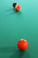 recreation(0.0), cue stick(0.0), carom billiards(0.0), indoor games and sports(1.0), sports(1.0), red(1.0), nine-ball(1.0), pool(1.0), games(1.0), billiard ball(1.0), eight ball(1.0), english billiards(1.0), ball(1.0), cue sports(1.0),