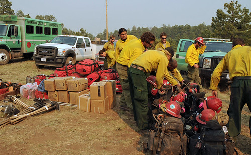 Morman Lake Hotshots check gear at a base camp. The backbone of U.S. Forest Service firefighting is the thousands of boots-on-the-ground men and women. (U.S. Forest Service)