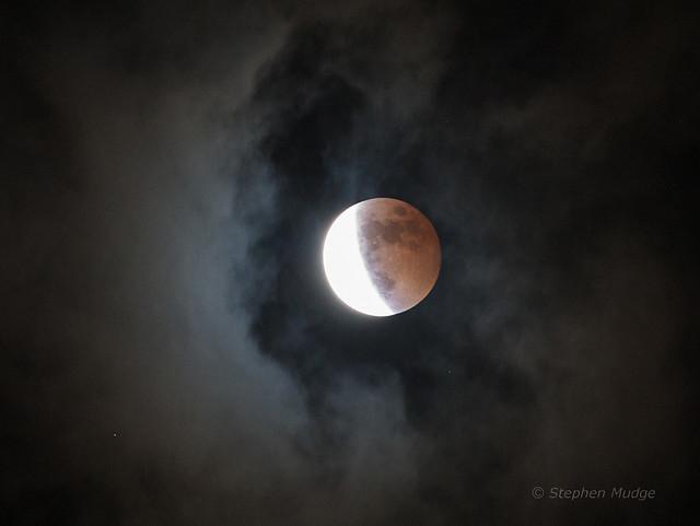 Lunar eclipse through clouds 2