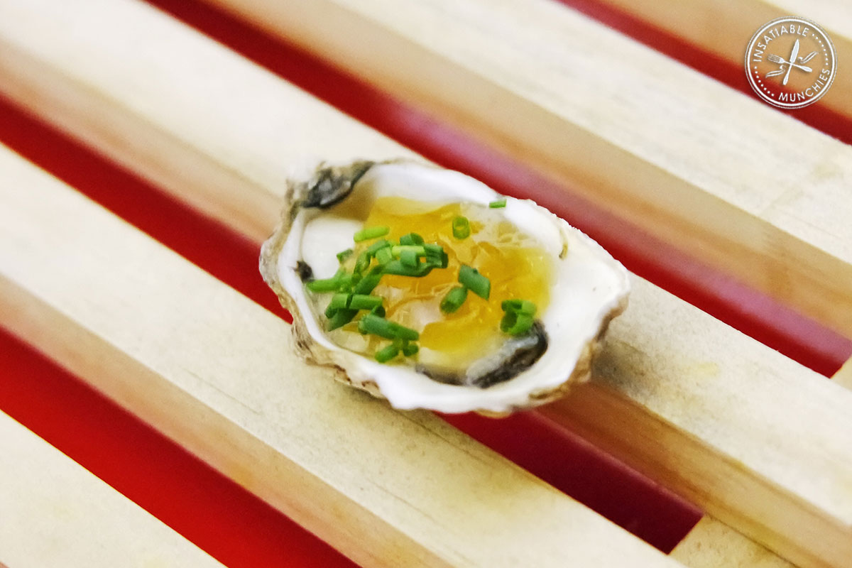 Oyster topped with yuzu jelly