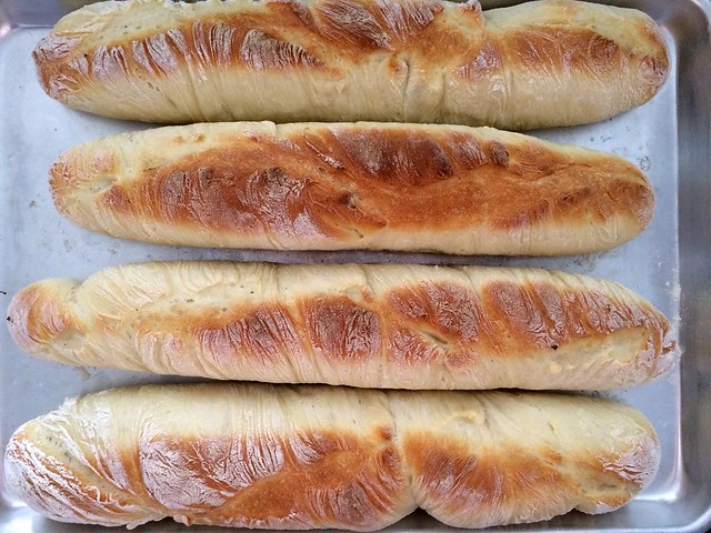 Baguettes Removed from Foil Molds for Final Bake