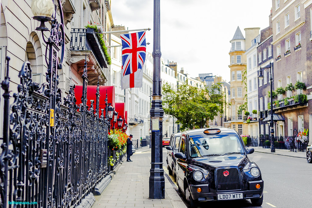 Beautiful houses in Mayfair, London with the typical black cab