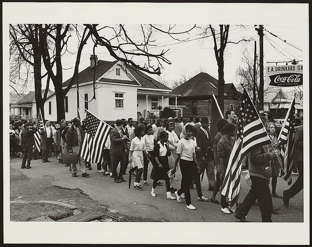 [Participants, some carrying American flags, marching in the civil rights march from Selma to Montgomery, Alabama in 1965] (LOC) from Flickr via Wylio