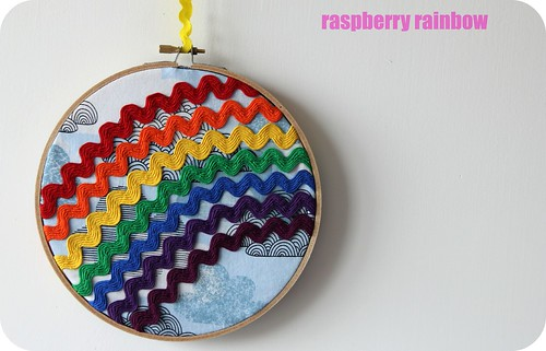 Rainbow ric rac on blue clouds