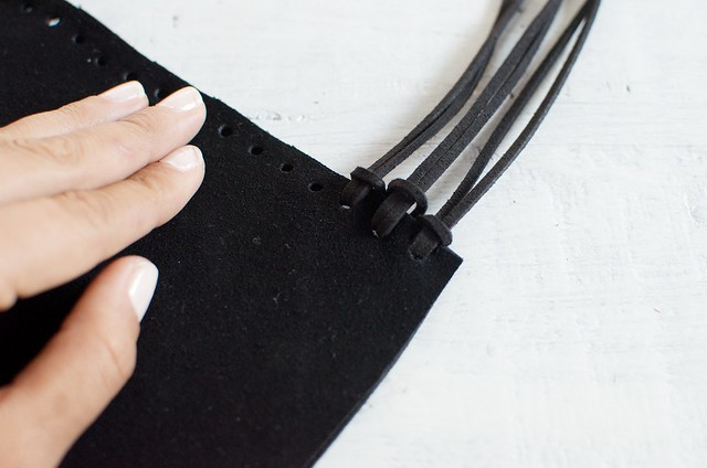Make a fringed leather clutch from scratch www.apairandasparediy.com
