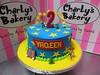 Toy Story themed birthday cake with plastic toy decorations