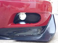 wheel(0.0), rim(0.0), grille(0.0), automobile(1.0), automotive tail & brake light(1.0), automotive exterior(1.0), vehicle(1.0), automotive lighting(1.0), bumper(1.0),