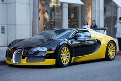 automobile(1.0), bugatti(1.0), wheel(1.0), vehicle(1.0), performance car(1.0), automotive design(1.0), bugatti veyron(1.0), land vehicle(1.0), supercar(1.0), sports car(1.0),