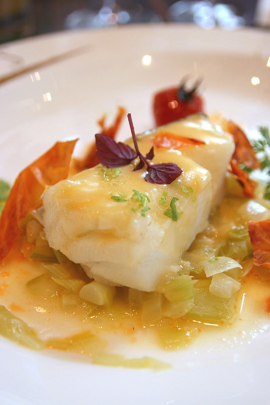 Poached Cod Fish with White Mary Vodka Beurre Blanc, Sauteed Leek and Celery, Slow Dried Cherry