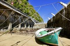 Mareas vivas con la marea baja en el puerto de Zarautz